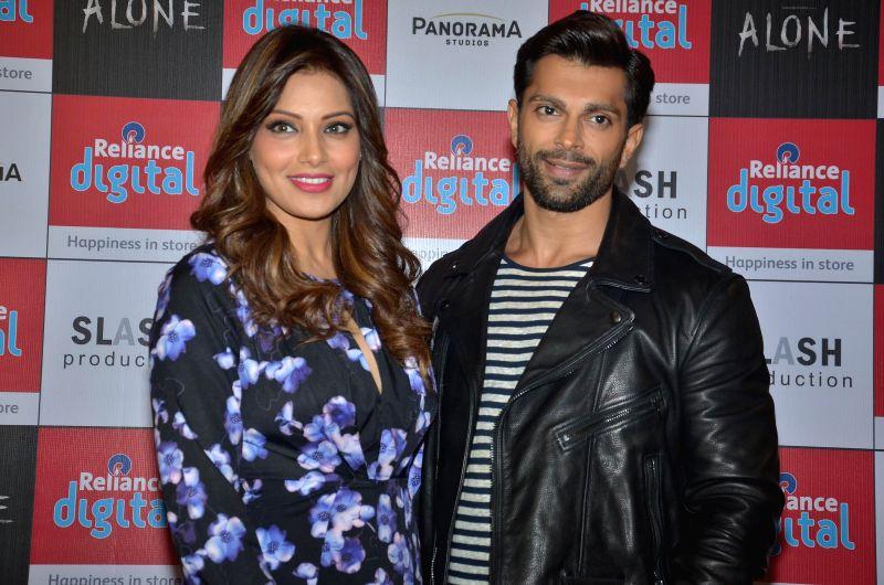 Bollywood actors Bipasa Basu and Karan Singh Grover during an event to promote their film `Alone` in Ahmedabad on Jan. 17, 2015. - Bipasa Basu and Karan Singh Grover