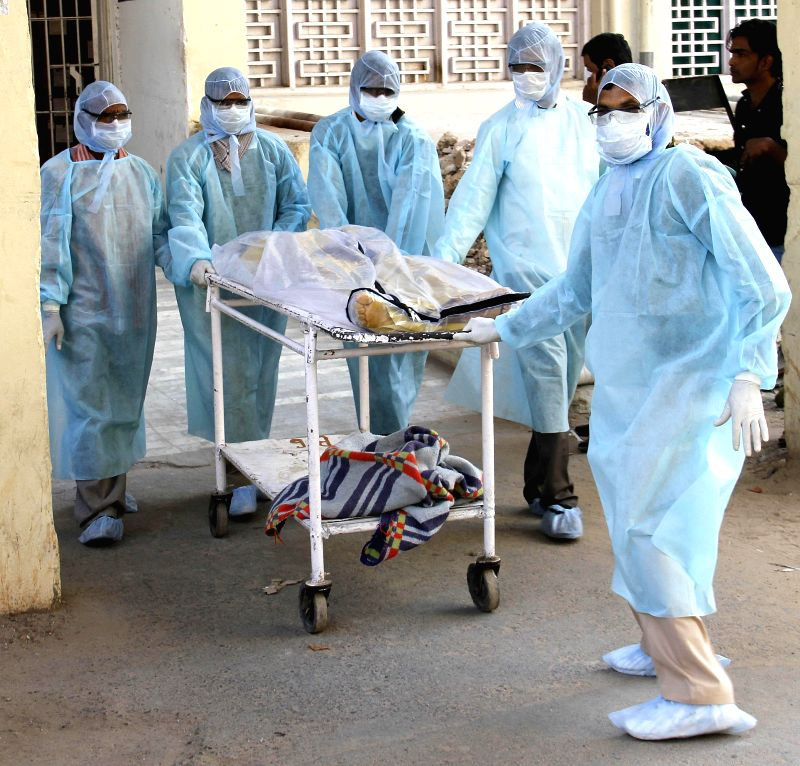 Doctors take away the body of a CRPF soldier who died of swine flu at Civil Hospital in Ahmedabad on Feb 14, 2015.