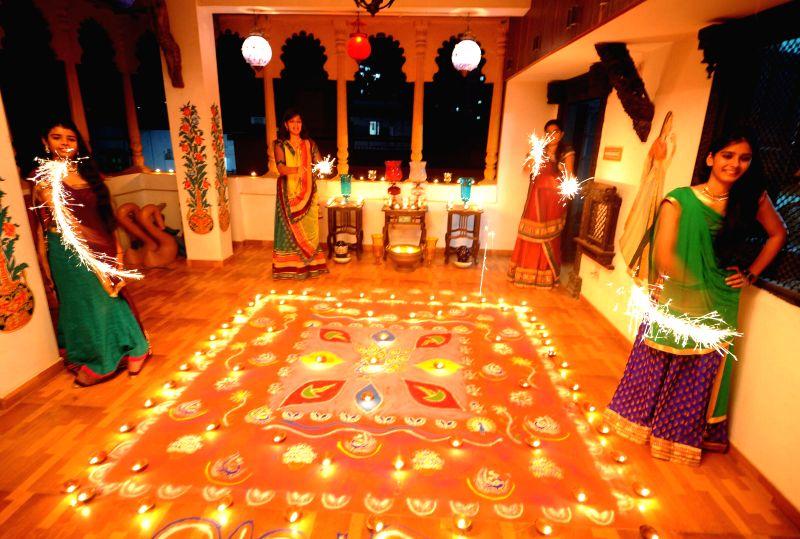 Girls celebrate Diwali with fireworks in Ahmedabad