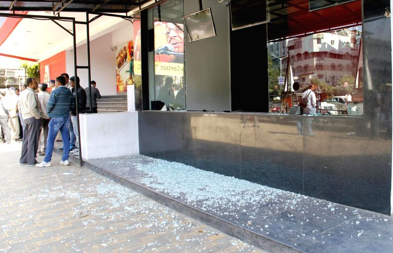 Glass shards strewn outside an Ahmedabad theatre screening Amir Khan starrer film `PK` on Dec 29, 2014. Bajrang Dal workers staged a protest against the film at the theatre. - Khan
