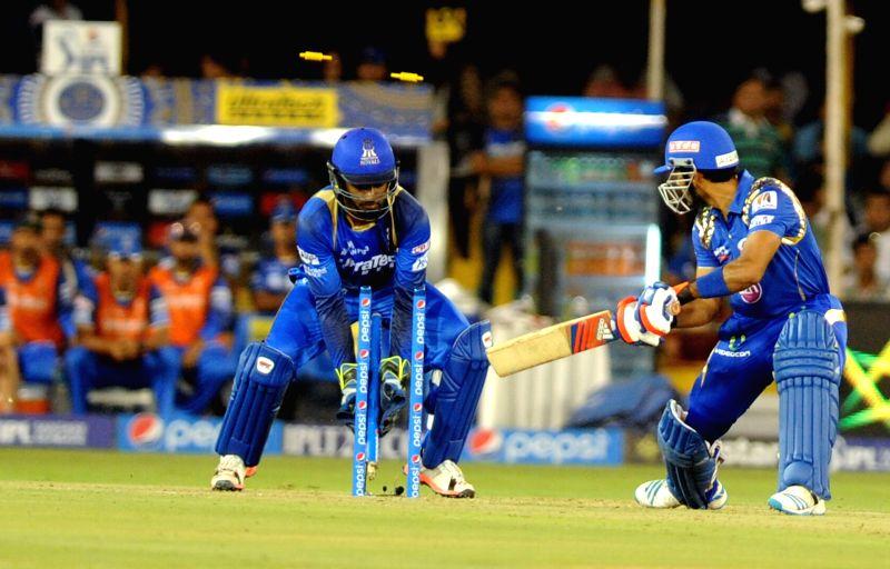 Mumbai Indians batsman Unmukt Chand gets dismissed during an IPL-2015 match between Rajasthan Royals and Mumbai Indians at Sardar Patel Stadium, in Ahmedabad, on April 14, 2015. - Unmukt Chand and Sardar Patel Stadium