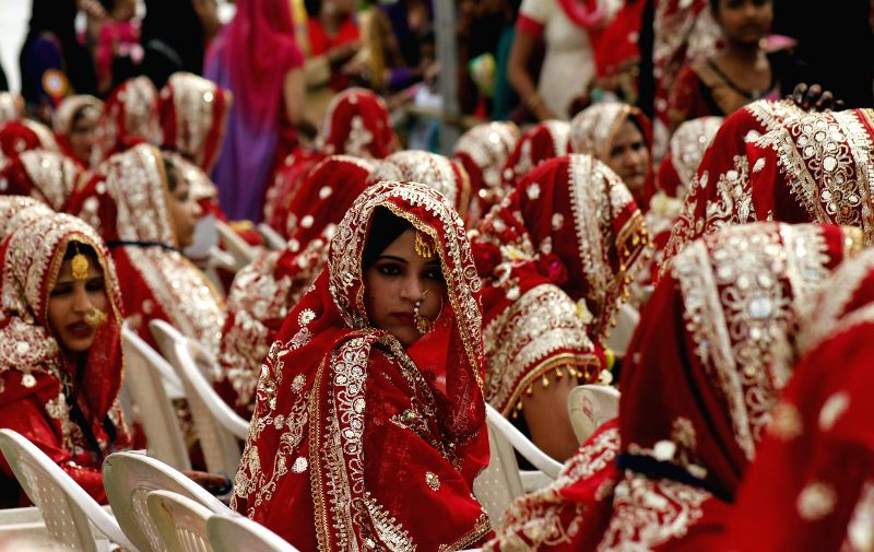Muslim brides during a mass marriage programme organised by an organisation in Ahmedabad, on Feb 15, 2015.