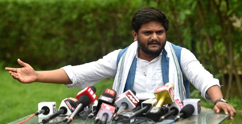 :Ahmedabad: Patidar Anamat Andolan Samiti (PAAS) convener Hardik Patel talks to the media, in Ahmedabad on July 25, 2018. A Gujarat court on Wednesday sentenced Patidar agitation spearhead Hardik ...