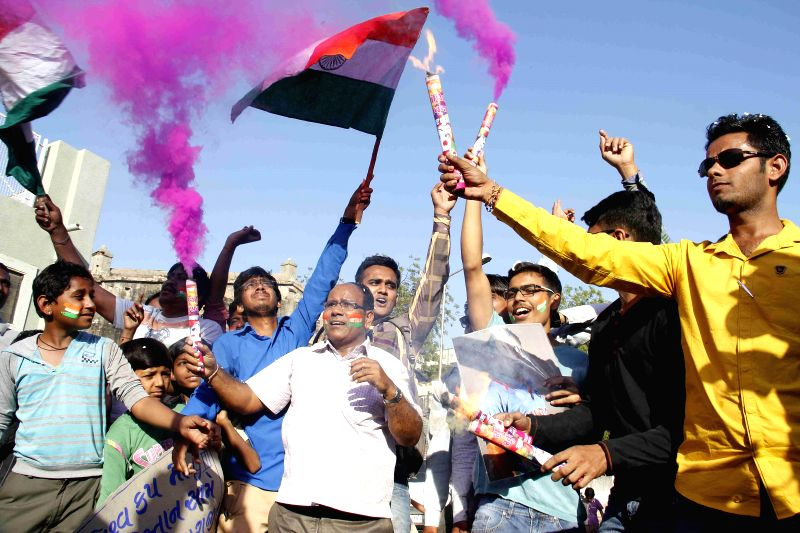 People celebrate India's victory over Bangladesh in the ICC World Cup - 2015 semi finals in Ahmedabad on March 19, 2015.