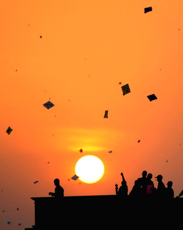 People fly kites from their roof-tops on Makar Sankranti in Ahmedabad on Jan 15, 2015.