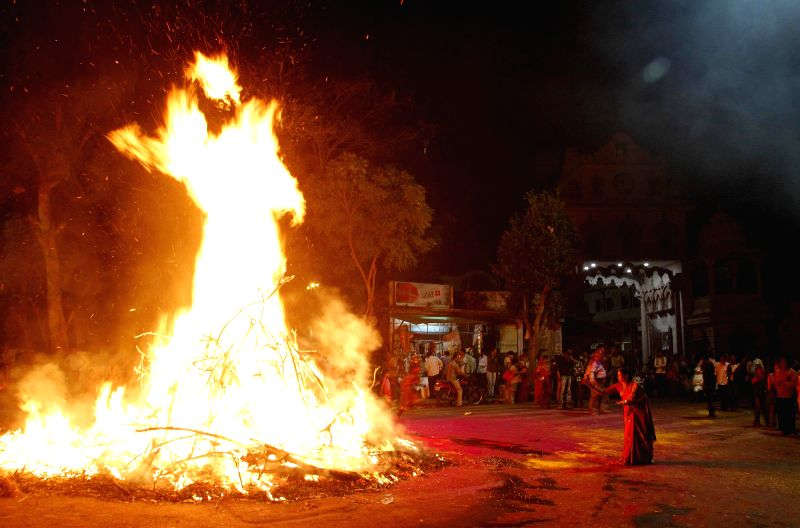 People participate in `Holika Dahan` - burning of the devil on the eve Holi in Ahmedabad, on March 5, 2015.