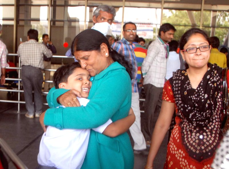 People stuck in earthquake hit Nepal being received by their relatives as they arrive at Sardar Vallabhbhai Patel International Airport in Ahmedabad, on April 27, 2015.