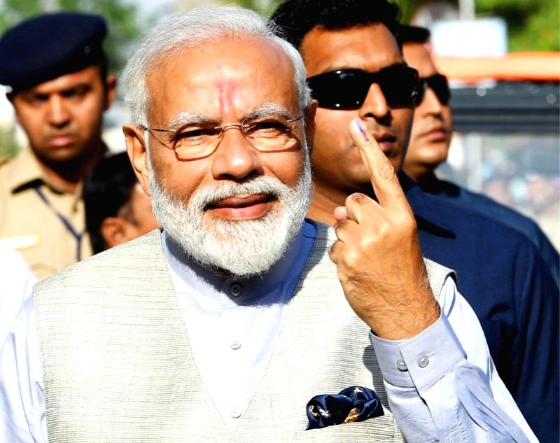 Ahmedabad : Prime Minister Narendra Modi  shows his forefinger marked with indelible ink after casting vote during the third phase of Lok Sabha polls, in Ahmedabad, Gujarat on April 23, 2019. (Photo: IANS)