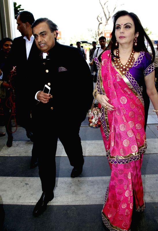 Reliance Industries Ltd (RIL) Chairman Mukesh Ambani and his wife Nita Ambani arrive at the Sardar Vallabhbhai Patel Airport to attend BJP chief Amit Shah's son's wedding in Ahmedabad, on . - Nita Ambani