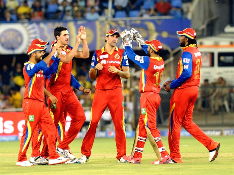 Royal Challengers Bangalore players celebrate fall of a wicket during an IPL-2015 match between Royal Challengers Bangalore and Rajasthan Royals at Sardar Patel Stadium, Motera, in ... - Ajinkya Rahane and Sardar Patel Stadium