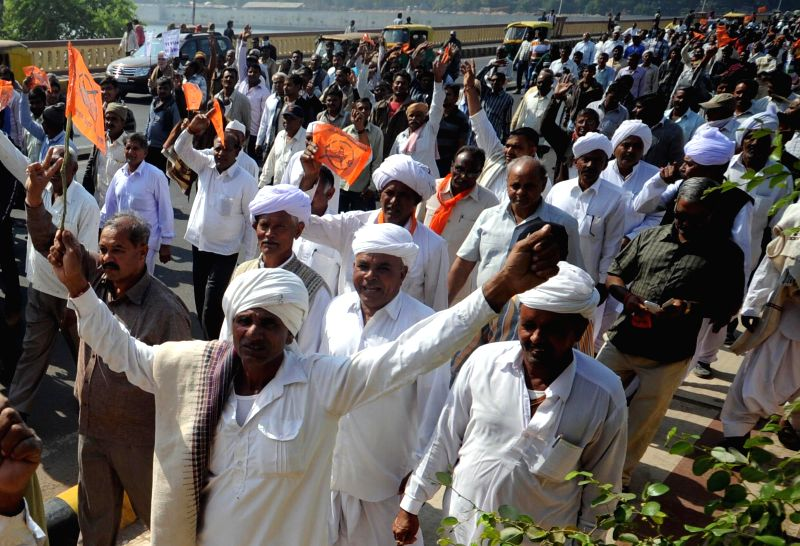 The members of Bharatiya Kisan Sangh during a rally regarding increment in minimum prices of cotton in Ahmedabad, on Dec 15, 2014.
