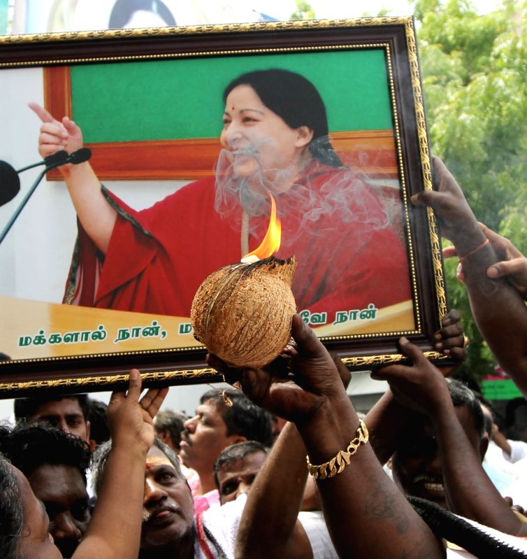 AIADMK workers celebrate party's performance in the recently concluded 2016 Tamil Nadu assembly polls at AIDMK headquarters in Chennai, on May 19, 2016.