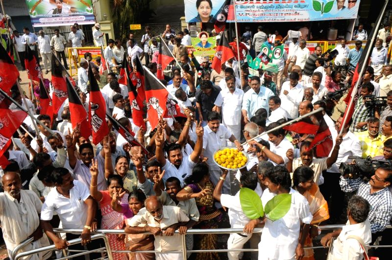 AIADMK workers celebrate their party's performance in the 2014 Lok Sabha Elections in Chennai on May 16, 2014.