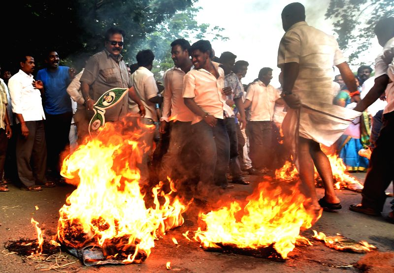 AIADMK workers demonstrate against Sri Lankan Government after derogatory remarks involving Tamil Nadu Chief Minister J Jayalalithaa and Prime Minister Narendra Modi were allegedly published in the .. - J Jayalalithaa and Narendra Modi