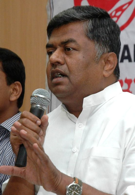 AICC General Secretary B K Hariparasd interacting with media at Press Club in Bangalore on April 12, 2014. (Photo : IANS)