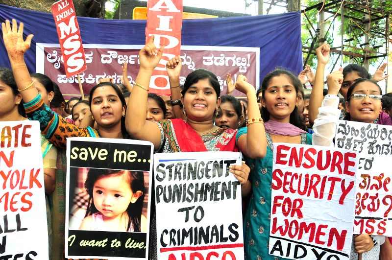 AIDSO activists stage a demonstration to press for safety of women in Bangalore on July 17, 2014.