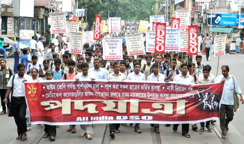 AIDSO activists take part in a protest rally against West Bengal Government in Kolkata on June 18, 2014.