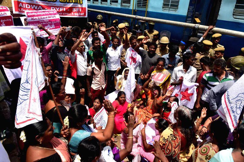 AIDWA-DYFI-SFI activists demonstrate against rail tariff hike at Chennai Central Railway station on June 25, 2014.