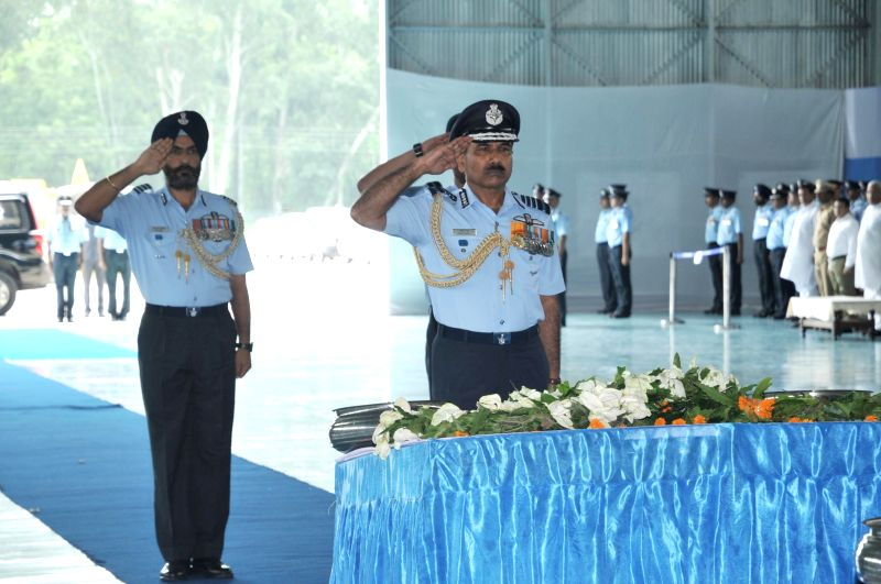 Air Chief Marshal Arup Raha pays tribute to the deceased air warriors of IAF helicopter crash at Air Force Station Bareilly on July 27, 2014.