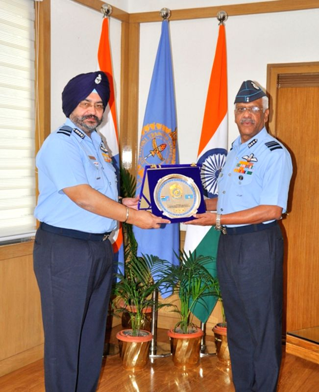 Air Officer Commanding-in-Chief, Training Command, Air Marshal S.R.K. Nair presents a memento to Air Chief Marshal B.S. Dhanoa during his visit to Headquarters Training Command, Indian Air ...