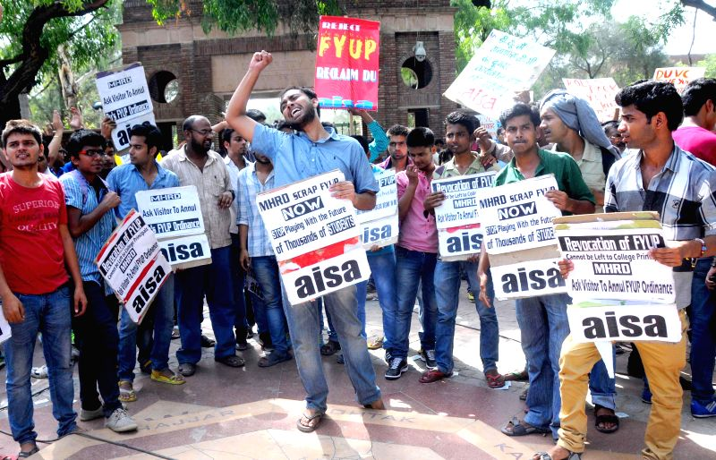 AISA activists celebrate after Delhi University VC Dinesh Singh resigned from his post in New Delhi on June 24, 2014. - Dinesh Singh