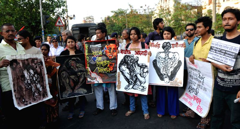 AISA activists take part in a demonstration against rapes in Kolkata on May 14, 2014.