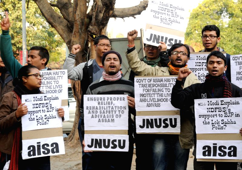 AISA and JNUSU activists stage a demonstration against the recent Assam violence in which 73 people were killed, at Jantar Mantar in New Delhi, on Dec 29, 2014.