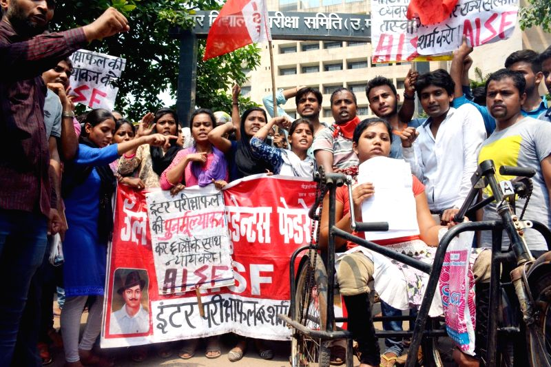 AISF activists stage a demonstration to press for their demands in Patna on June 2, 2017.