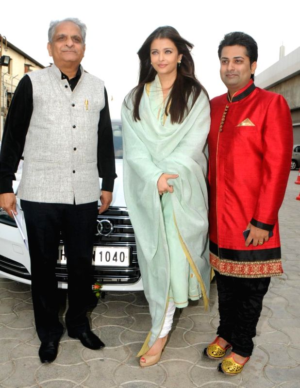 Aishwarya Rai Bachchan snapped posing with her Audi A8 car at the National Sports Club of India in Mumbai on April 27, 2014.