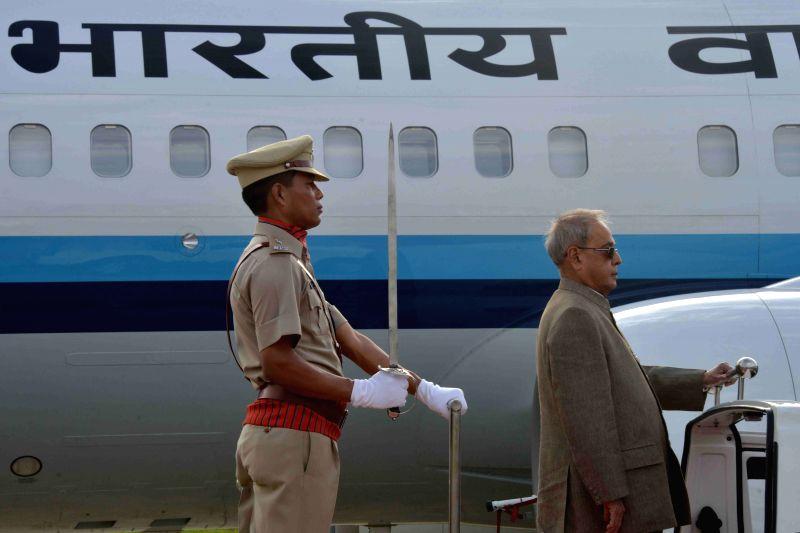 President Pranab Mukherjee inspects guard of honour at the Lengpui Airport in Aizawl, Mizoram on April 9, 2015. - Pranab Mukherjee