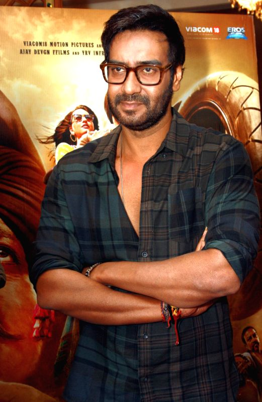 """Ajay Devgan and Sonakshi Sinha at a promotional event for the film """" Son of Sardar"""",in New Delhi.(Photo : IANS/Amlan) - Ajay Devgan and Sonakshi Sinha"""