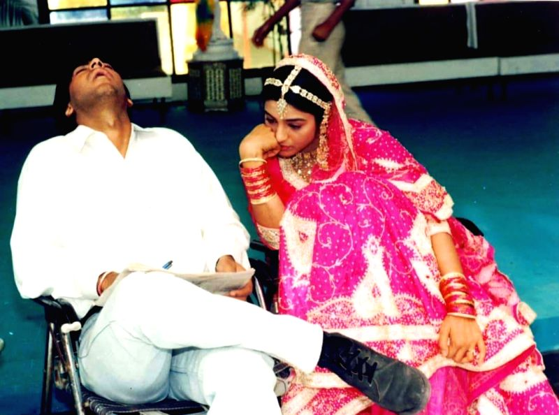 """Ajay posted the image on Twitter. In the photograph, the """"Singham"""" star can be seen sleeping with his mouth wide open while Tabu is sitting beside him, looking completely bored."""