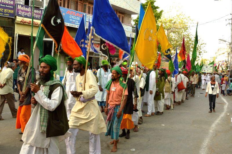 People participate in a procession organised on the urs of Hazrat Khwaja Moinuddin Hasan Chishty - Khwaja Gharib Nawaz -  in Ajmer, on April 19, 2015.