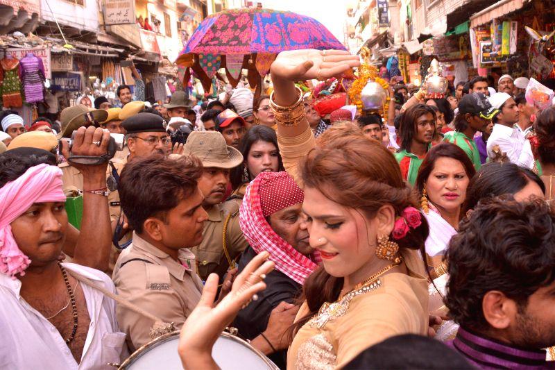 Transgenders arrive at the shrine of Khwaja Moinuddin Chishti to offer `chaadar` in Ajmer on April 27, 2015.