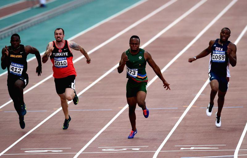 Akani Simbine(2nd R) of South Africa competes during Men's 100m Final at the 28th Summer Universiade in Gwangju, South Korea, on July 9, 2015. Akani Simbine won the ...