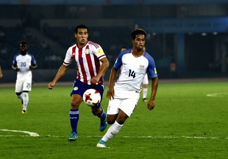 Akil Watts (White Jersey No 14) of USA and Fernando Cardozo (Red Jersey No 17) of Paraguay  in action during a Round of 16 match of FIFA U-17 World Cup 2017 between Paraguay and USA at ...