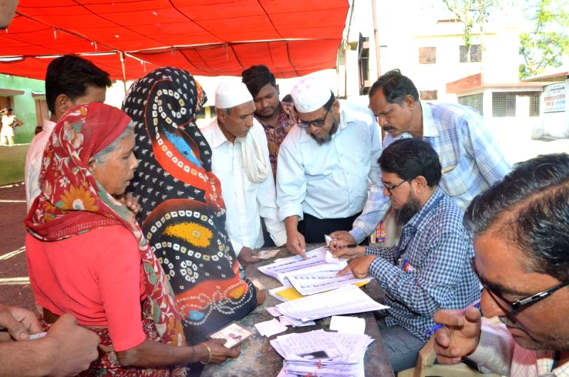 Akola (Maharshtra): Voters check their names in the voters' list as they arrive to cast their votes for the second phase of 2019 Lok Sabha elections in Maharashtra's Akola, on April 18, 2019. (Photo: IANS/PIB)