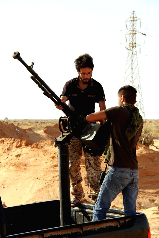 Fighters of the Islamist armed coalition Libya Dawn combat at the front line near al-Aqrabiyah, Libya, on May 4, 2015. Clashes erupted on Monday between Libya ...
