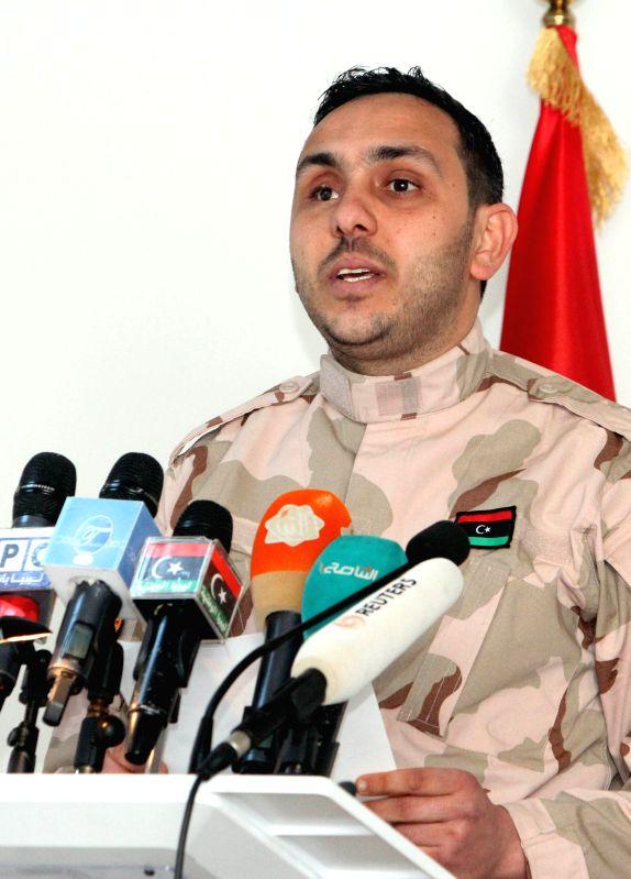 Muhannad al-Mahgob, spokesperson for a Libya Dawn's allied armed group, addresses a press conference in al-Azizia, Libya, on March 28, 2015. Al-Mahgob said on ...