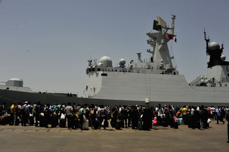 AL-HODAYDA(YEMEN), March 30, 2015 Chinese citizens wait to get on the a navy frigate to leave Yemen, in the al-Hodayda port in western Yemen, on March 30, 2015. Four hundred and ...