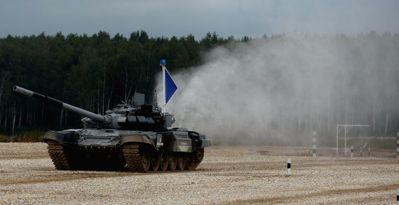 A Russian tank competes during the Tank Biathlon world championship in Alabino, Russia, Aug. 16, 2014. Russia won the team championship of the Tank Biathlon world ..