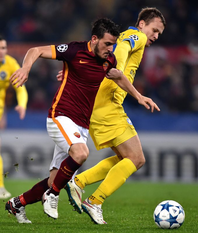 Alessandro Florenzi (L) of Roma vies with Denis Polyakov of Bate Borisov during the UEFA Champion's League football in Rome, Italy, Dec. 10, 2015. Roma won 2-0. ...