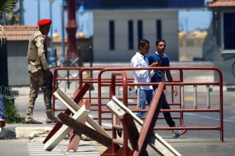 ALEXANDRIA, May 20, 2016 - Egyptian soldiers stand in front of the Egyptian naval base amid tight security after finding the wreckage of the EgyptAir plane near Alexandria, Egypt on May 20, 2016. The ...