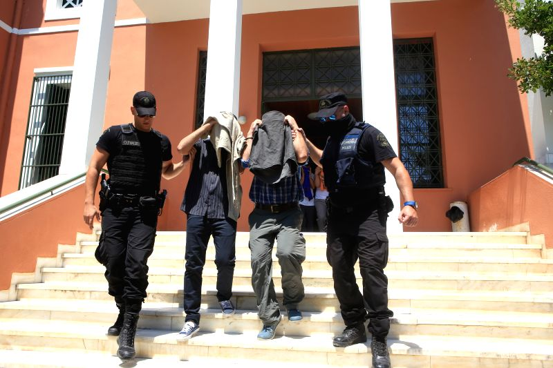 ALEXANDROUPOLIS, July 18, 2016 - Policemen escort Turkish military officers, who fled to Greece in a military helicopter on Saturday after the failed coup in Turkey, out of a court in ...