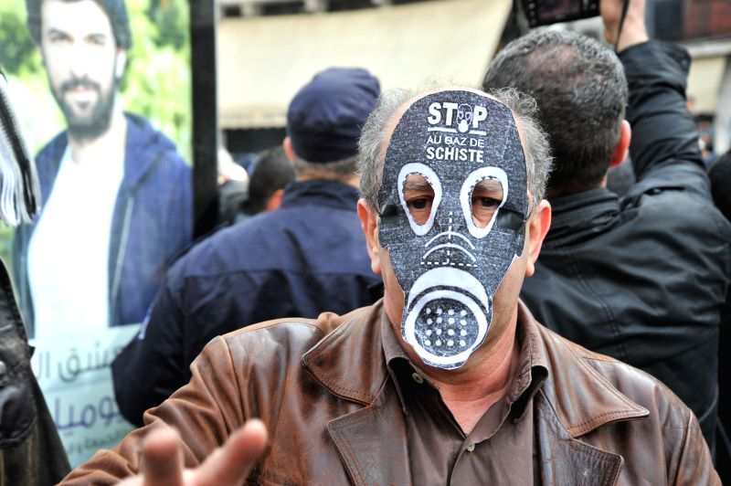 An Algerian protester attends a demonstration called by associations and opposition parties against the exploitation of shale gas in Algiers, the capital of Algeria ...