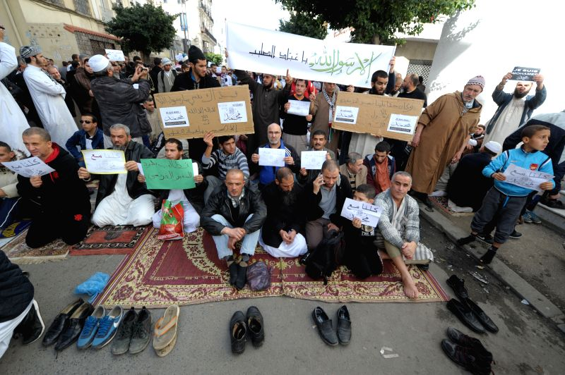 Algerian people protest against sarcastic cartoons on the Prophet of Islam Muhammad, which have been published in the latest edition of French weekly Charlie Hebdo,