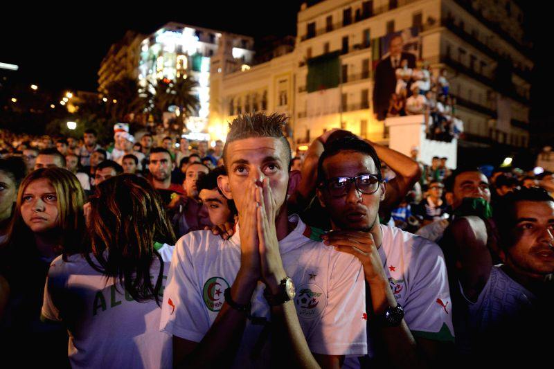 Algerian fans show their disappointment as they watch the 2014 World Cup match Between Algeria and Germany in downtown Algiers, Algeria, June 30, 2014. Algeria lost .