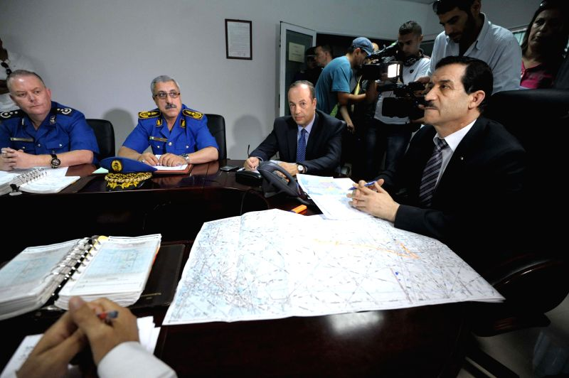 An Algerian crisis unit, chaired by Minister of Transport Amar Ghoul (R), meets at the Houari-Boumediene International Airport in Algiers on July 24, 2014, ...