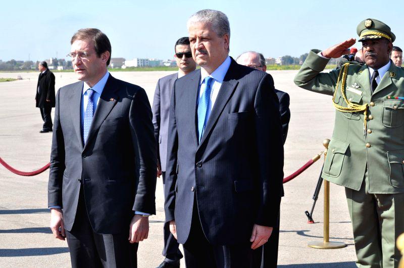 Portuguese Prime Minister Pedro Passos Coelho (L) and his Algerian counterpart Abdelmalek Sellal (R) inspect the guard of honor at Houari Boumediene International ... - Pedro Passos Coelho