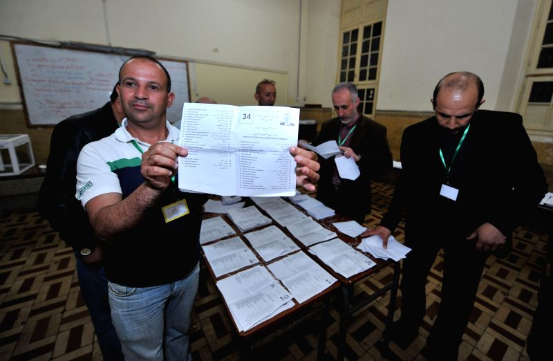 ALGIERS, May 4, 2017 - A scrutineer presents a ballot at a polling station in Algiers, Algeria on May 4, 2017. Algeria's new lower house parliamentary elections kicked off on Thursday to choose its ...